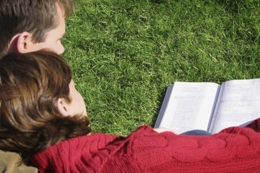 A couple reading together : Stock Photo