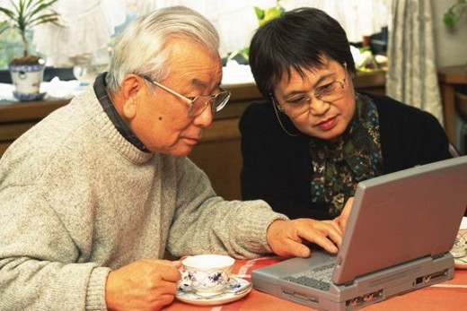 Senior adult man and woman using a laptop computer, High Angle View : Stock Photo