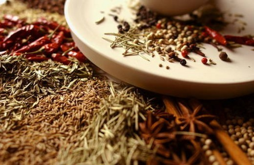 Various spices around mortar and pestle, close up : Stock Photo
