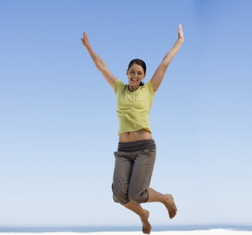 Stock Photo: 4029R-164557 A young woman jumping