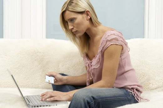 Stock Photo: 4029R-166222 Young woman shopping on the internet
