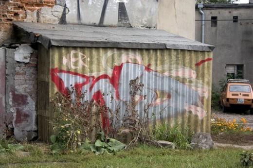 Stock Photo: 4029R-166284 Graffiti on tin storage building