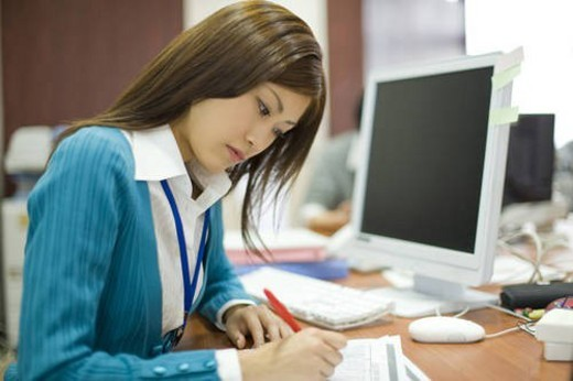Stock Photo: 4029R-167924 A Woman Working in the Office