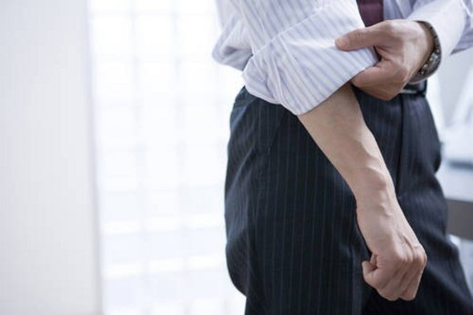 Business Scene, Man Rolling Up Sleeves : Stock Photo