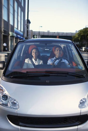 Mid-Adult Couple Driving Smart Car : Stock Photo