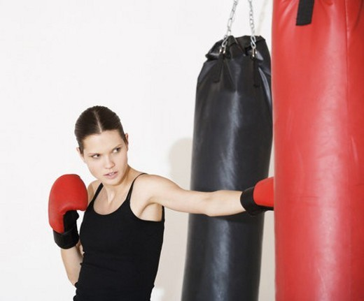 Stock Photo: 4029R-170802 A young woman boxing