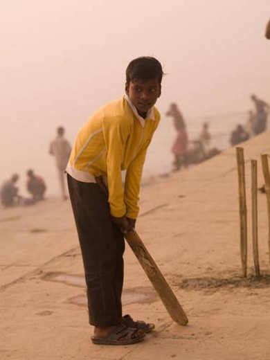 Young boy in India holding a cricket bat : Stock Photo