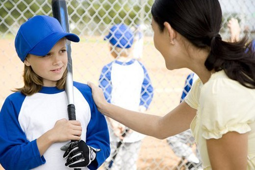 Stock Photo: 4029R-173232 Mother encouraging daughter at youth league baseball game