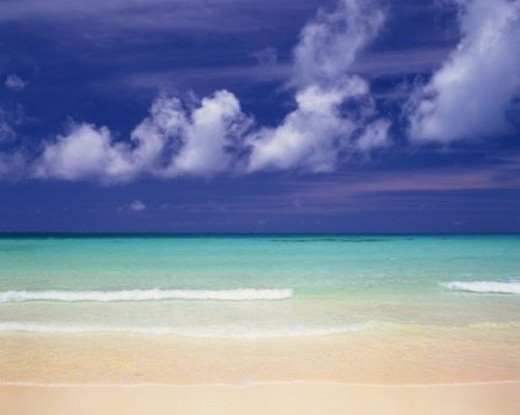 Stock Photo: 4029R-173686 Tropical Beach and the Clouds Sailing in the Blue Sky, Pan Focus