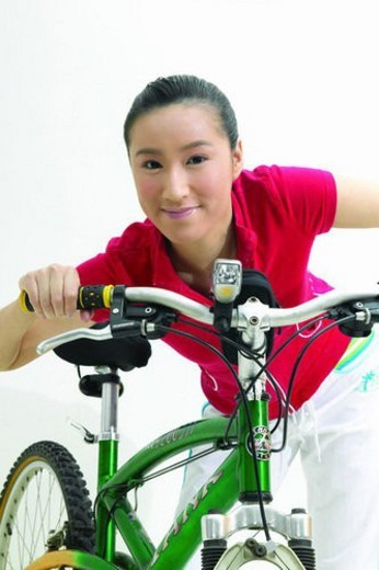 Stock Photo: 4029R-176297 Bending, Casual Clothing, Black Hair, Bicycle, Asian Ethnicity
