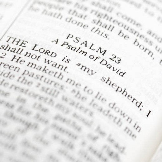 Stock Photo: 4029R-176373 Selective focus of Psalm verses in open Holy Bible.