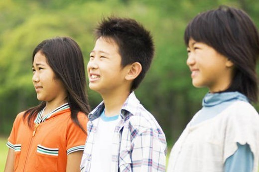 Group of children standing in a row : Stock Photo