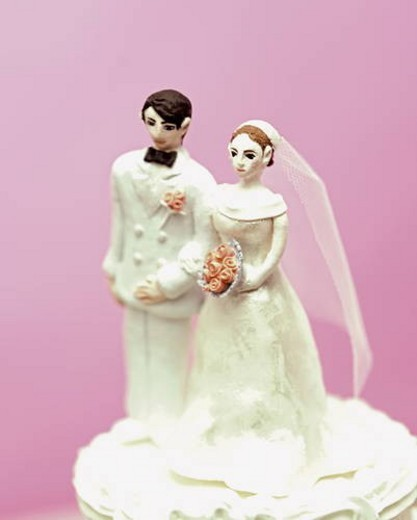 Stock Photo: 4029R-179282 Wedding cake topped with bride and groom figurines
