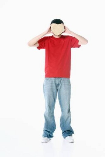 Stock Photo: 4029R-180154 a boy with a heart covering his face