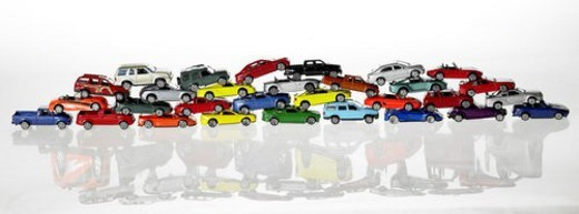 Pile of various coloured model cars : Stock Photo