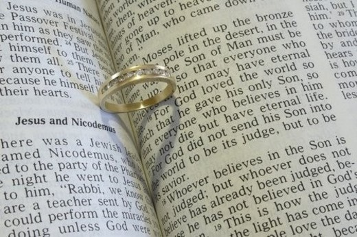 Closeup of a wedding ring with bible : Stock Photo