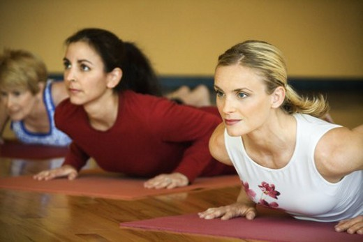 Stock Photo: 4029R-183121 Caucasian prime adult females in yoga class.