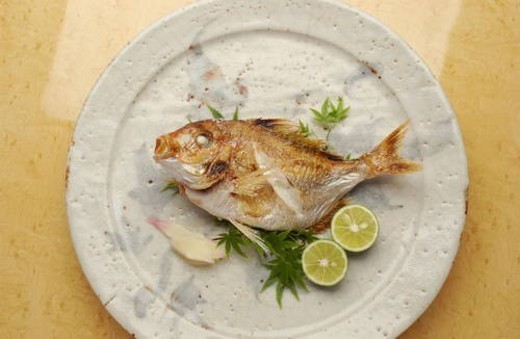 Plate of grilled sea bream : Stock Photo