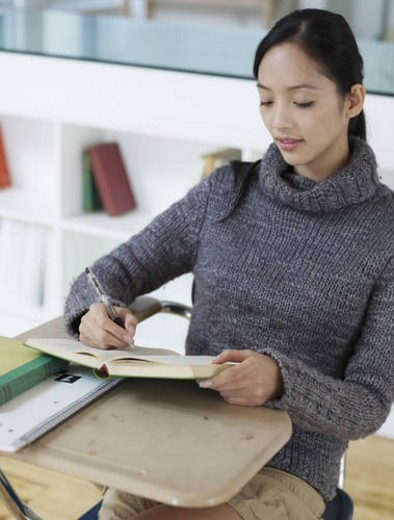 Mid Adult Woman Writing in Notebook : Stock Photo