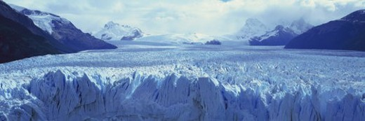 Panoramic view of icy formations of a glacier : Stock Photo
