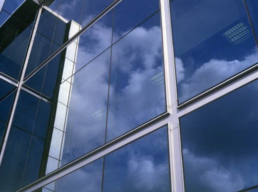 Clouds reflecting in office block windows : Stock Photo