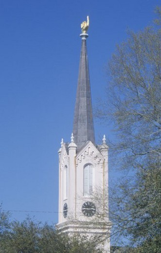 Church steeple showing finger pointing upward : Stock Photo
