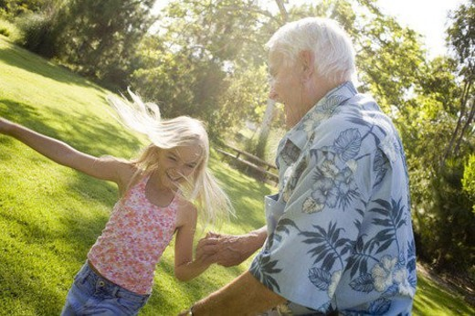 Grandfather and Granddaughter in park : Stock Photo