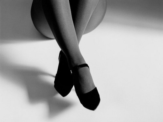Stock Photo: 4029R-191834 Woman s legs with high heels sitting down, High Angle View, Black and White