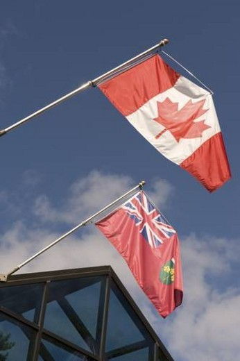 Stock Photo: 4029R-195665 Canadian flag and Ontario flag, Muskoka, Ontario, Canada