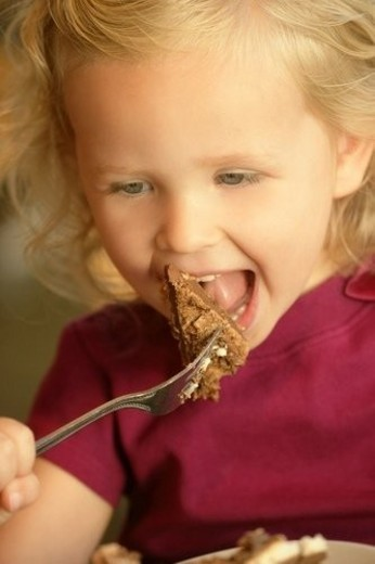 Stock Photo: 4029R-195679 Little girl eating cake