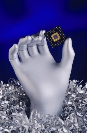 Silver Hand holding Computer Chip : Stock Photo