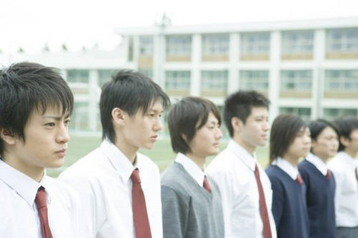 Boys standing side by side in campus : Stock Photo