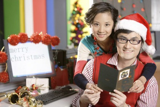 Stock Photo: 4029R-199200 Intimating young lovers with Christmas card