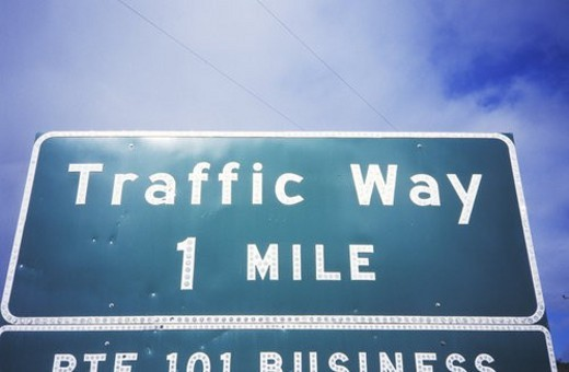 "A sign that reads ""Traffic Way 1 Mile"" : Stock Photo"