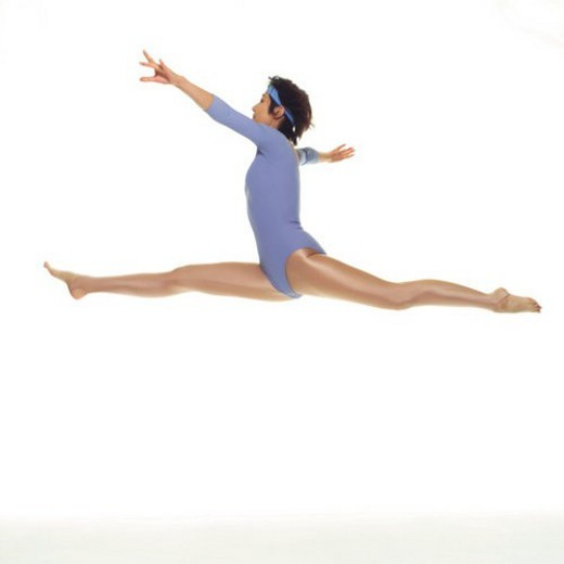 A woman in Leotard jumping, Side View, Copy Space : Stock Photo
