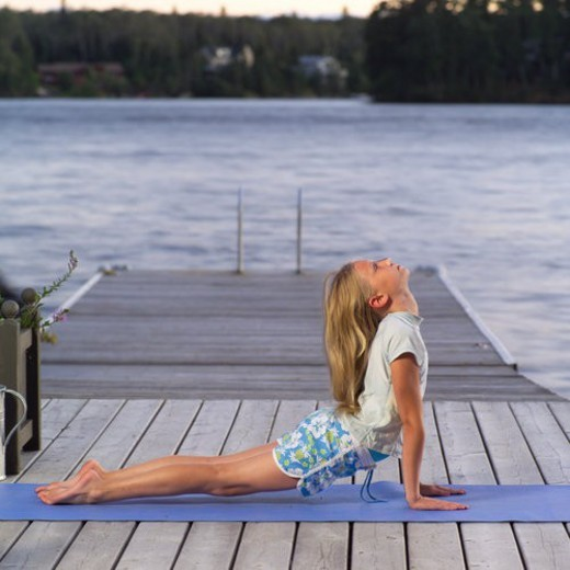 Stock Photo: 4029R-205969 Teenage girl doing yoga