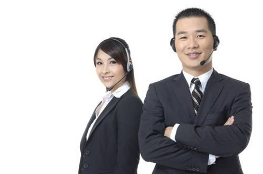 Stock Photo: 4029R-210066 Portrait of a male and a female customer care executives smiling