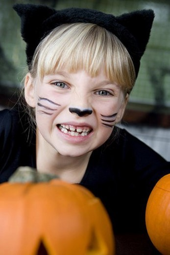 Stock Photo: 4029R-210127 Little girl in a cat outfit dressed up for Halloween