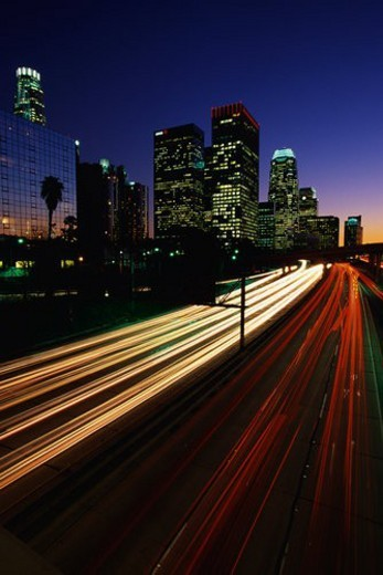 Harbor Freeway with the streaked lights from rush hour traffic at sunset : Stock Photo