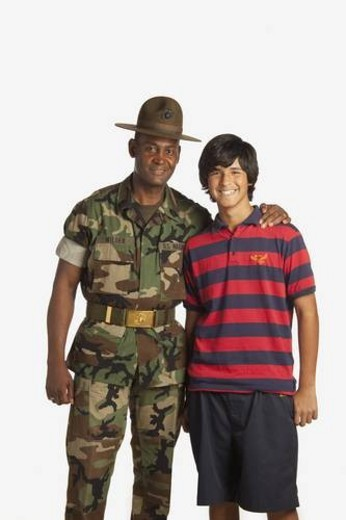 fort lauderdale, florida, united states of america; a military man with his arm around a teenage boy : Stock Photo