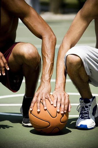 Stock Photo: 4029R-212911 Two  African American kneeling side by side on an urban basketball court, close up
