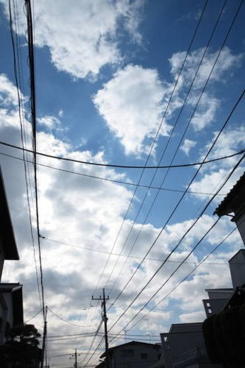 Clouds and power lines, Tokyo prefecture, Japan : Stock Photo