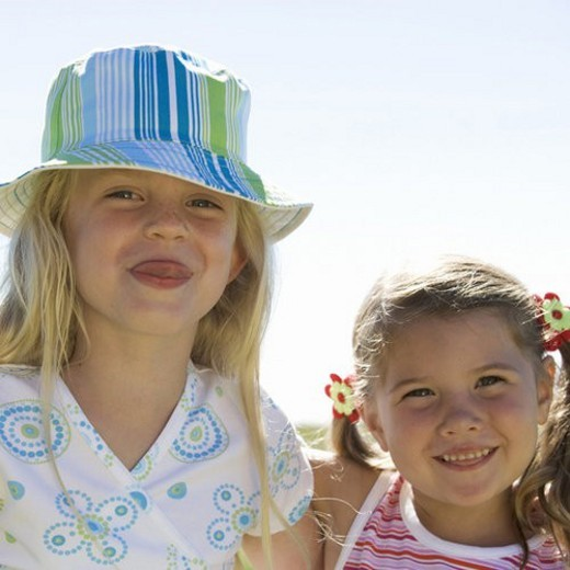 Portrait of two young girls : Stock Photo