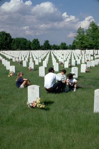 Dad age 35 and children age 3 through 9 Fort Snelling Military Cemetery on Memorial Day. Minneapolis Minnesota USA : Stock Photo