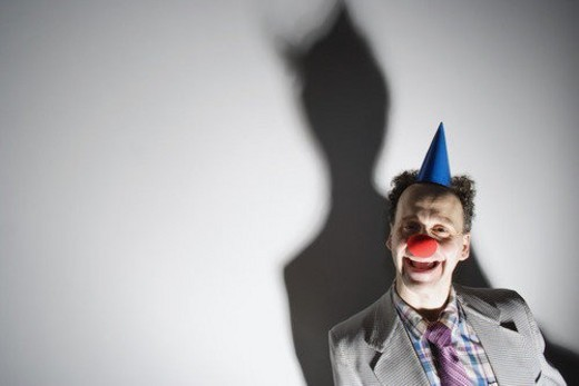 Stock Photo: 4029R-215048 Man wearing a clown s nose and hat
