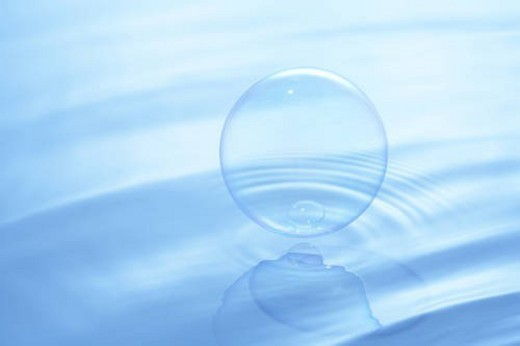 Stock Photo: 4029R-218834 Soap bubbles on water surface, blue background