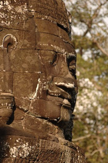 Stock Photo: 4029R-218899 Stone carving of a face on wall at Khmer Kingdom palace ruins