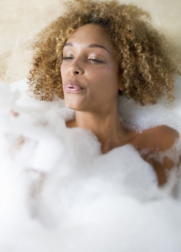 Portrait of a young woman in a bath : Stock Photo