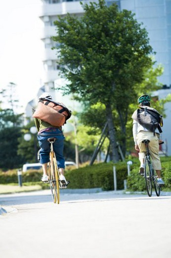 Stock Photo: 4029R-221069 Two Messengers Who Run By A Bicycle All Over A Town