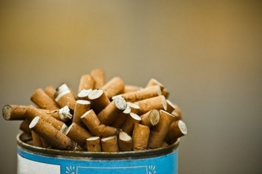 Can of cigarette butts : Stock Photo